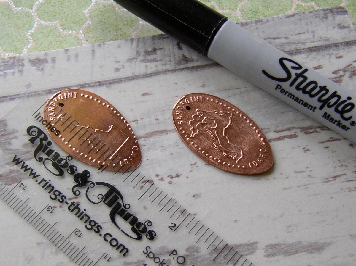 Souvenir Pressed Penny Earrings mark the charm for hole position.