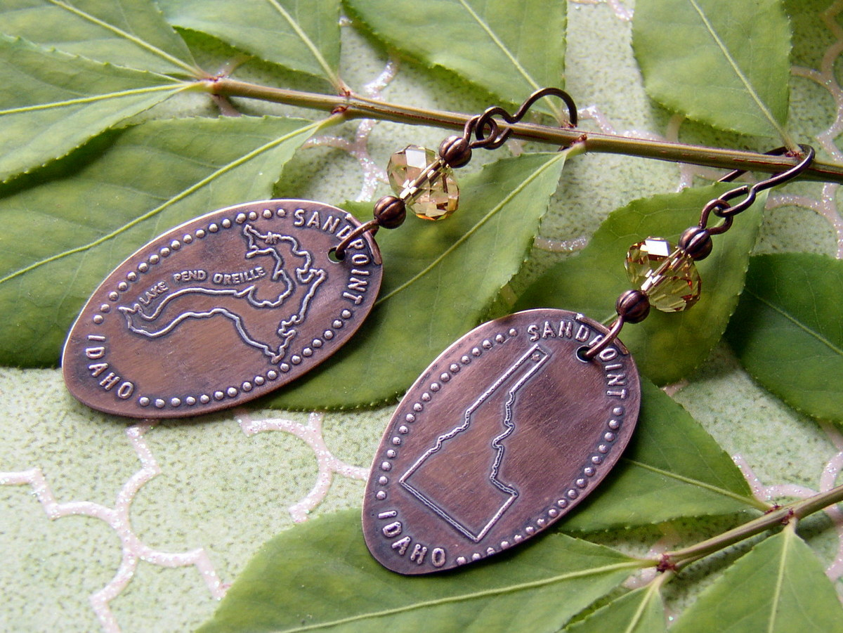 It is easy to turn your souvenir pressed pennies into keepsake jewelry.