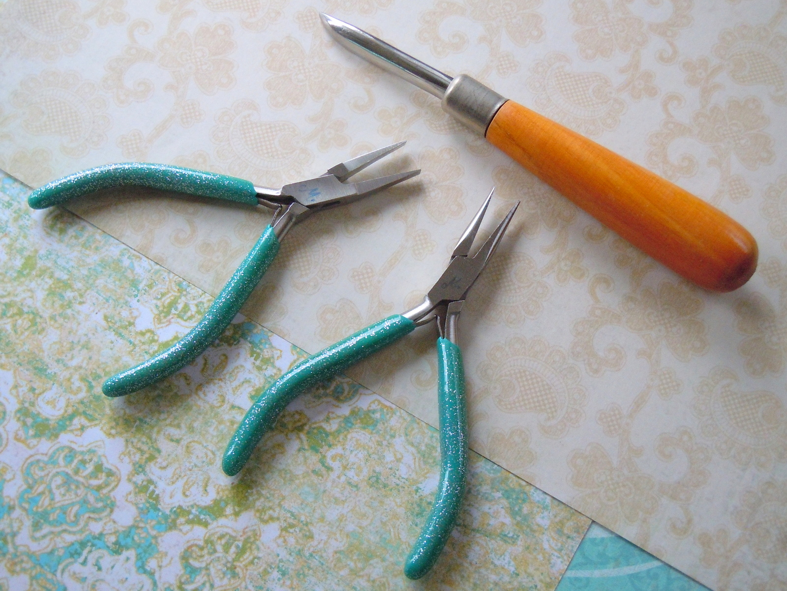 This jewelry-making project requires just three tools: flat-nose pliers, chain-nose pliers, and a steel burnisher.